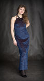 The girl in a dark blue evening dress Stock Photo