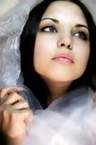 Girl with dark blue eyes in a silk scarf Stock Photos