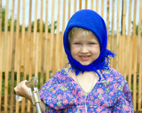 Girl in a dark blue scarf Royalty Free Stock Photos