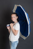 Girl with a dark blue umbrella Royalty Free Stock Images
