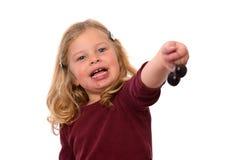 Girl with dark cherry Royalty Free Stock Photo
