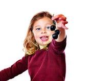Girl with dark cherry Royalty Free Stock Image