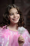 Girl with dark curly hair Stock Photography