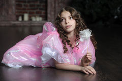 Girl with dark curly hair Royalty Free Stock Images
