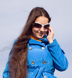 A girl in dark glasses talking on cell phone Royalty Free Stock Photography