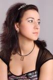 Girl with dark hair Stock Photos