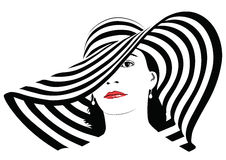 Girl with dark hair in big striped hat -  Stock Photography