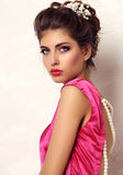 Girl with dark hair and bright makeup with accessories stock photos