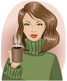 Girl in cozy green sweater holding a hot mug. Girl with dark hair in a cozy green sweater holding a hot mug with a drink, winter mood Stock Photo