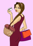 Girl with dark hair and dark eyes holding a credit card and three colored bags Royalty Free Stock Photo