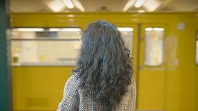 Girl with dark hair looks in a trace departing train The Berlin Underground subway metropolitan. Girl with dark hair looks in a trace departing train Berlin stock video footage
