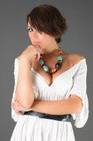 Girl with dark hair poses Stock Photography