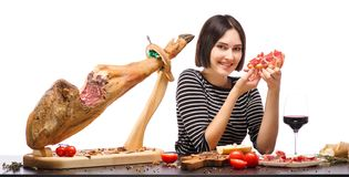 A girl is holding a sandwich with meat and a cute smile. Isolated over white background royalty free stock image