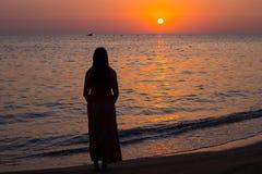Girl and the sea. Sunrise on the sea coast Royalty Free Stock Photos