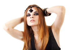 Girl in a dark makeup with bead Stock Photography