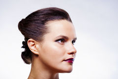 Girl in dark makeup looking aside Stock Image