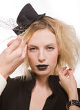 Girl with dark old-fashioned make up in hat Stock Photos