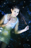 Girl in a dark river water Royalty Free Stock Photography