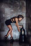 Girl in a dark room Royalty Free Stock Photos
