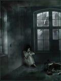 Girl in a dark room Royalty Free Stock Photo