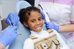 Girl with a dark-skinned child on reception at the dentist Royalty Free Stock Images