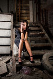 Girl on the dark stairs Royalty Free Stock Photography