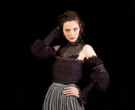 Girl in dark Victorian dress Stock Image