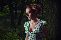 Girl in dark wood. Beautiful girl in dark wood royalty free stock image