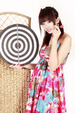 Girl with dart. Attractive girl holding a dart and dartboard on white Stock Photo