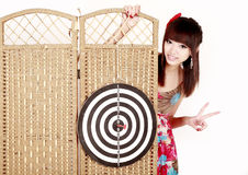 Girl with dartboard Royalty Free Stock Photos