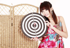 Girl with dartboard Stock Images