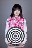 Girl with darts. Stock Images