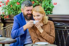 Girl dating with businessman. Dating businessman. Couple cuddling cafe terrace. Couple in love sit cafe terrace enjoy. Coffee. Things know before you date royalty free stock photography