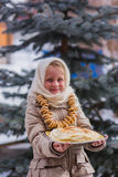 Girl on the day of the carnival treats pancakes Stock Images