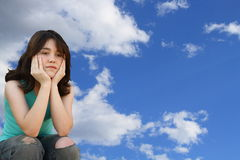Girl daydreaming. Young teen girl daydreaming in the sky Royalty Free Stock Photo