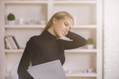 Girl daydreaming in office Royalty Free Stock Photography