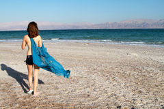 Girl at dead sea beach. Beautiful girl  on the dead sea beach from the back Royalty Free Stock Photography