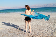 Girl at dead sea beach Stock Photos