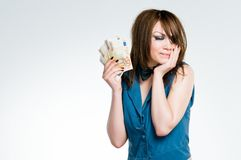 Girl in dealers outfit holding euro Royalty Free Stock Photo