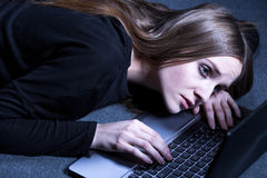 Girl dealing with suicidal thoughts. Searching help in internet stock photo