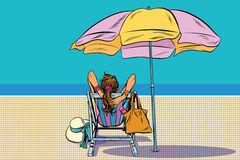 Girl in a deckchair on the beach. Pop art retro vector. The rest of the sea. Travel and tourism Royalty Free Stock Photo