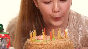 Girl decorate a birthday cake, cake scattered stock footage