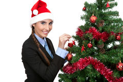 Girl decorate a christmas tree Royalty Free Stock Photography