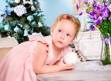 Girl decorate the Christmas tree Stock Photos