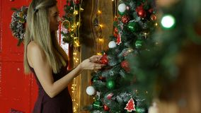 Young girl decorate Christmas tree Royalty Free Stock Photo
