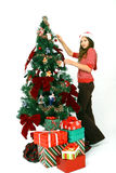 Girl decorate the tree Royalty Free Stock Photo