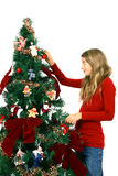 Girl decorate the tree Royalty Free Stock Images