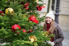 Girl with decorated Christmas tree Royalty Free Stock Images