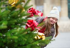 Girl with decorated Christmas tree Royalty Free Stock Image