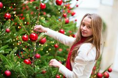 Girl with decorated Christmas tree Stock Photos